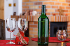 Still life with wine bottles, glasses and heart symbol Stock Photos