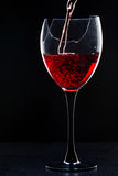 Still-life with the wine broken glass on black. Still-life with the wine glass on black background. white stand Royalty Free Stock Photography