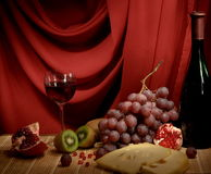 Still-life with a wine, cheese and a grapes Royalty Free Stock Image