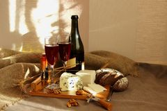 Still-life with wine and cheese Royalty Free Stock Image