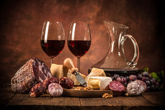Still life with wine, cheese and sausages Stock Photography