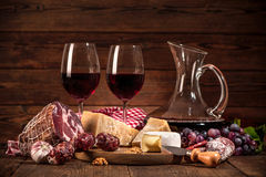 Still life with wine, cheese and sausages Royalty Free Stock Image