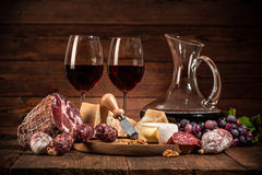 Still life with wine, cheese and sausages Stock Images