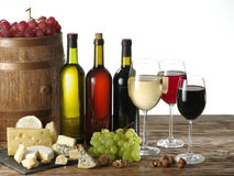 Still-life with wine, cheeses and fruits. Stock Photos