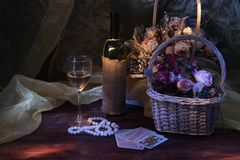 still life with wine and flowers stock photos