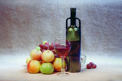 Still-life with wine and fruits Stock Images