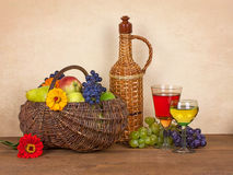 Still life with wine, fruits and flower Stock Photo