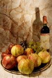 Still life with wine and fruits Stock Images