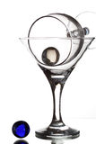 Still-life with wine glass and glass beads on a white background Royalty Free Stock Photo