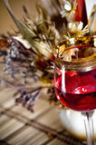 The still life with wine glass and bouquet Stock Images