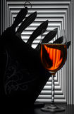 Still life with wine glass and knives Stock Photos