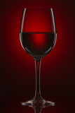 Still-life with the wine glass on a red gradient Stock Images