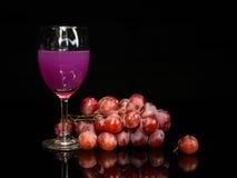 Still life wine and grape Stock Photos