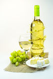 Still life with wine, grapes and cheese Stock Image