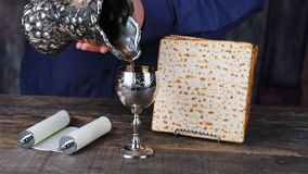 Still-life with wine and matzoh jewish passover bread stock video footage