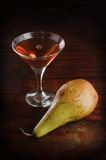 Still-life With Wine and a pear Stock Images