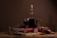 Still life with wine and sausage Royalty Free Stock Images