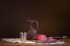 Still life with wine and sausage Royalty Free Stock Image