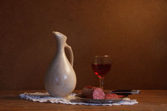 Still life with wine and sausage Royalty Free Stock Photography