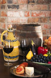 Still life with wine and some fruits,vegetables, Royalty Free Stock Image
