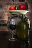 Still life with wine and some vegetables Stock Photography