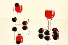 Still-life with wineglasses and cherries Royalty Free Stock Photo