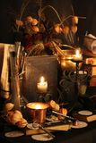 Black Magic Spells. Wiccan spells. Still life Witchcraft composition with candles, crystal, magic book and pentagram symbol. Halloween and occult concept, black Stock Image