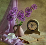 Still Life With A Bow And Clock Royalty Free Stock Photography