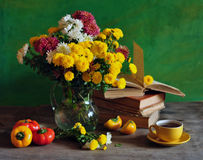 Still Life With Chrysanthemums And Books Stock Photo