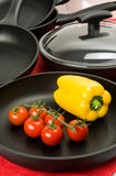 Still-life With Fry Pans And Vegetables Royalty Free Stock Photography