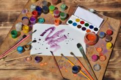 Free Still Life With Painted Sheet Of Paper And Jars Of Watercolor An Stock Photography - 115508772