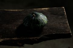 Still life on wooden background. Squash in the rustic cellar. Harvest stock photography