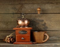 Still life of wooden coffee grinder cinnamon sticks. And star anise royalty free stock photography