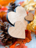 Still Life of Wooden Hearts Amongst Autumn Foliage Stock Images