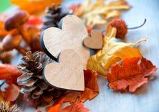 Still Life of Wooden Hearts Amongst Autumn Foliage Stock Image