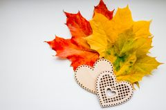 Still Life of Wooden Hearts and colorful leaves.autumn still life, copy space, dark background, autumn composition. Still Life of Wooden Hearts Amongst Autumn Royalty Free Stock Photography