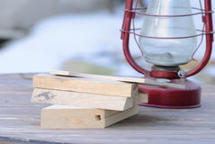 Still life of wooden planks and oil lamp. On a wooden table with a blurred background Stock Photography