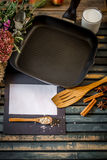 still life on a wooden table with  grill pan and  utensils Royalty Free Stock Photos