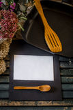 still life on a wooden table with grill pan and utensils stock images