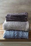 Still Life with Wool Sweaters and Leg Warmers. Still Life with Gray and Brown Wool Sweaters and Leg Warmers royalty free stock photography