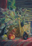 Still life written in oil. A bouquet of autumn flowers in a basket, a black spoon with a painting and an apple Stock Image