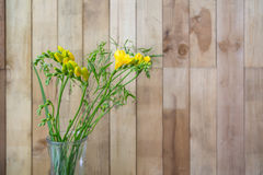 Still life of yellow freesia flowers on wooden background Royalty Free Stock Photo