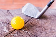 Still life Yellow Miniature Golf Ball On White Background. Stock Photos