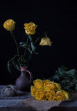 Still life with yellow withered flowers Stock Photo