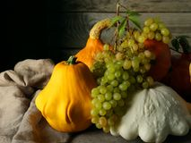 Still life with zucchini, pumpkin, squash and grape. Seasonal vegetables and fruit beautifully stacked on the table Royalty Free Stock Photography