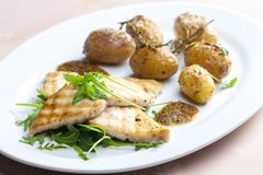 Still lifegrilled cod with potatoes. Gastronomy, cuisine, food, meal, nutrition, nourishment, healthy, vegetarian, cooked, plate, fish, rocket stock photos
