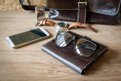 Still lift with leather bag, watch , lighter , glasses and smart Royalty Free Stock Photography