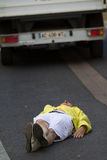 Still man lying on the road Royalty Free Stock Photos