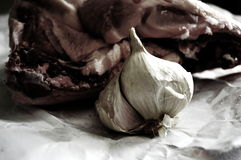 Still nature with garlic and fresh meat Royalty Free Stock Photo