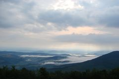 Panorama of the cloudy sky above the Borzhava ridge. The still nature of the Ukrainian Carpathians under the thunderous clouds of an impending storm Stock Photos